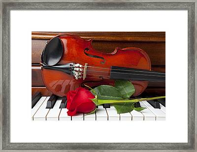 Violin With Rose On Piano Framed Print by Garry Gay