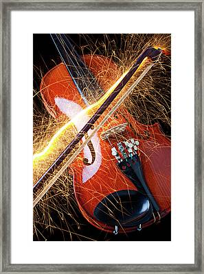 Violin With Sparks Flying From The Bow Framed Print by Garry Gay