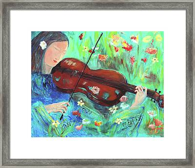 Violinist In Garden Framed Print