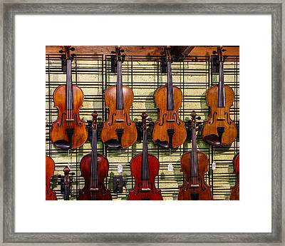 Violins In A Shop Framed Print