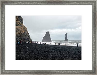 Framed Print featuring the photograph Visitors In Reynisfjara Black Sand Beach, Iceland by Dubi Roman