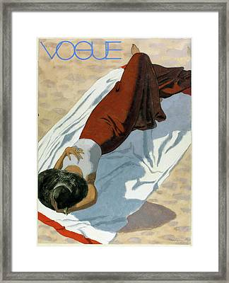 Vogue Cover Featuring A Woman Lying On A Beach Framed Print by Pierre Mourgue