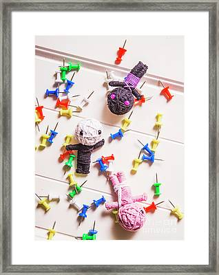 Voodoo Dolls Surrounded By Colorful Thumbtacks Framed Print