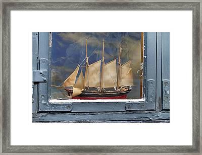 Voyage In A Window Framed Print