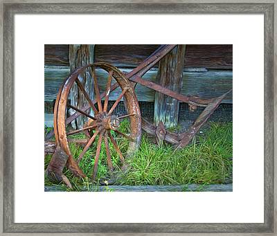 Framed Print featuring the photograph Wagon Wheel And Fence by David and Carol Kelly