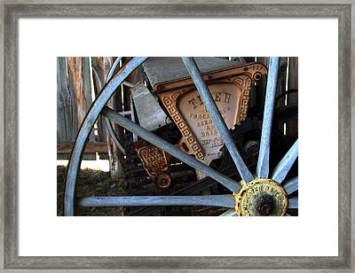 Framed Print featuring the photograph Wagon Wheel And Grass Seeder by Joanne Coyle