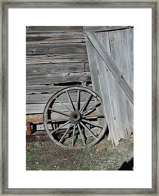 Framed Print featuring the photograph Wagon Wheel by Nancy Taylor