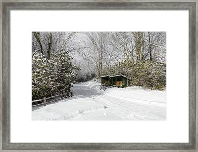 Wagon Wheels And Firewood Framed Print
