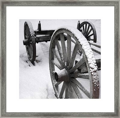Wagon Wheels In Snow Framed Print by Linda Drown