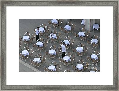 Waiters At Empty Cafe Terrace On Piazza San Marco Framed Print by Sami Sarkis