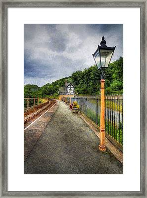 Waiting For The Train Framed Print by Ian Mitchell