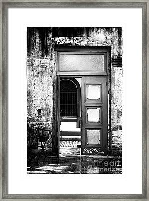 Waiting Past The Door Framed Print