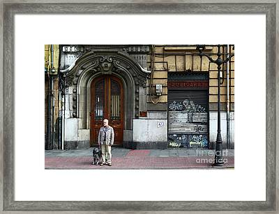 Waiting To Cross The Road In Bilbao Framed Print by James Brunker