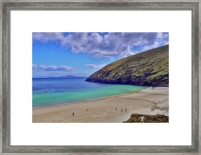 Walkers On Keem Beach, Achill Island Feted By The Green Atlantic Ocean. Framed Print by Paul Mc Namara