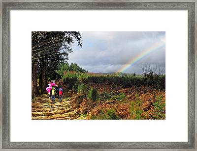 Walkers With Rainbow Framed Print by Rod Jones