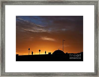 Framed Print featuring the photograph Walking At Sunset by Les Bell