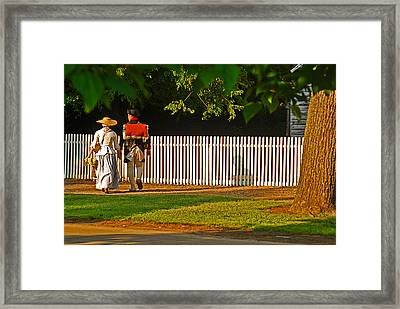 Walking Couple - Williamsburg Framed Print by Panos Trivoulides