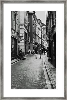 Walking In Gamla Stan Framed Print by Louise Fahy