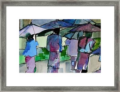 Walking In The Rain Framed Print by Jane Ferguson