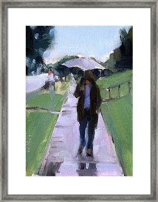 Walking In The Rain Framed Print by Merle Keller