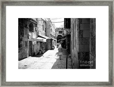 Walking In The Shade Framed Print by John Rizzuto