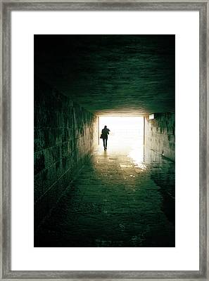 Walking Into The Light Framed Print by Carlos Caetano
