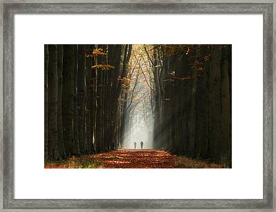 Walking Into The Light Framed Print by Martin Podt