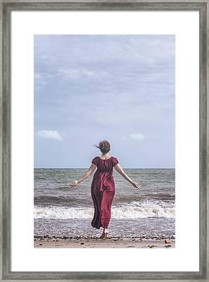 Walking Into The Sea Framed Print by Joana Kruse