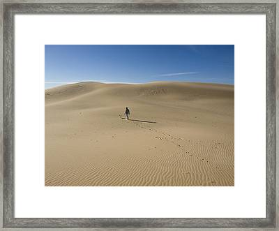 Walking On The Sand Framed Print by Tara Lynn