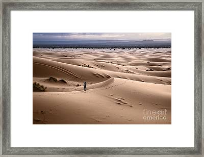 Walking The Desert Framed Print by Yuri Santin