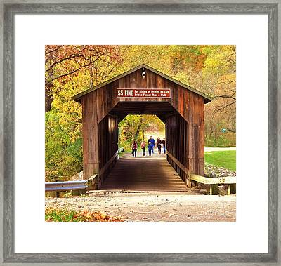 Walking The Historic Fallasburg Covered Bridge Framed Print by Terri Gostola
