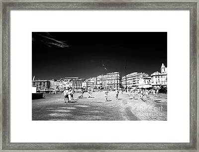 Walking The Old Port Framed Print by John Rizzuto