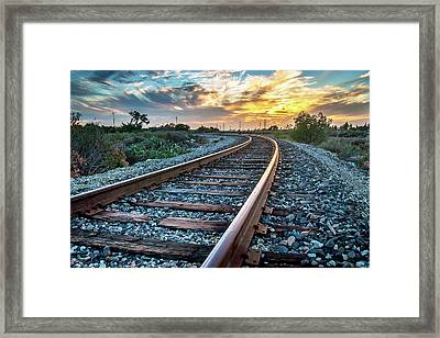 Walking The Rails Framed Print by Aron Kearney