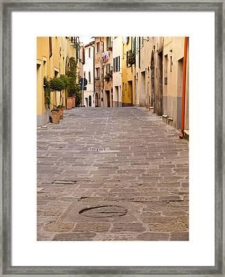 Walking Through Montepulciano Framed Print by Rae Tucker