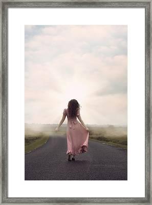 Walking Towards The Sun Framed Print by Joana Kruse