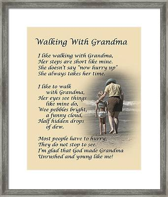 Walking With Grandma Framed Print by Dale Kincaid