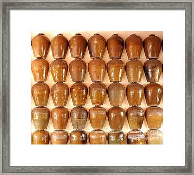 Framed Print featuring the photograph Wall Of Ceramic Jugs by Yali Shi