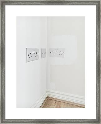 Wall Plugs Framed Print by Tom Gowanlock