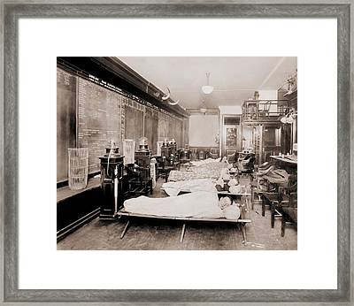 Wall Street Clerks Sleeping In Office Framed Print by Everett