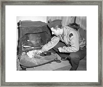 War Reporter Burns Notes Framed Print by Underwood Archives