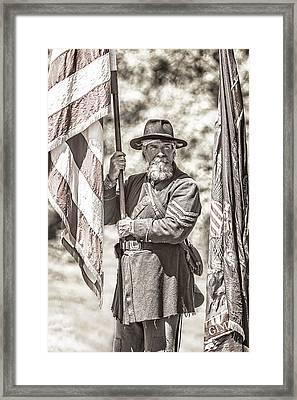 War Torn Flag Bearer Framed Print by Wes and Dotty Weber