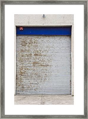 Warehouse Door Framed Print by Tom Gowanlock