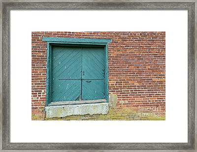 Warehouse Loading Door And Brick Wall Framed Print