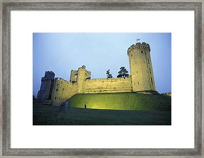 Warwick Castle At Dawn With A Man Framed Print by Richard Nowitz