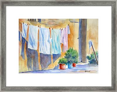 Wash Day In Marsaxlokk Framed Print by Marsha Elliott