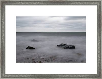 Washing Over The Beach Framed Print by Andrew Pacheco
