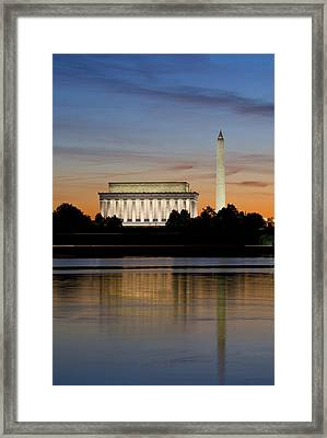Washington Dc From The Potomac River Framed Print by Brendan Reals