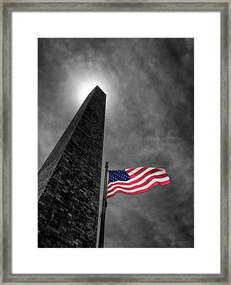 Washington Monument And The Stars And Stripes Framed Print by Andrew Soundarajan