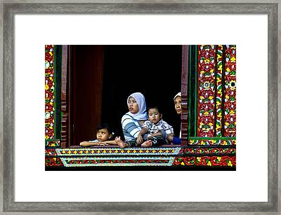 Watching From A Window Framed Print by Charuhas Images