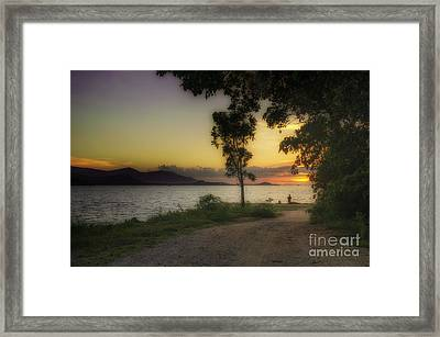 Watching Sunset Framed Print by Michelle Meenawong